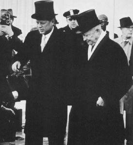 President JFK wearing a hat on his way to Capitol Hill on the day of his inauguration.