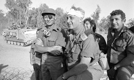 Ariel Sharon (bandaged) and Moshe Dayan during the Yom Kippur War